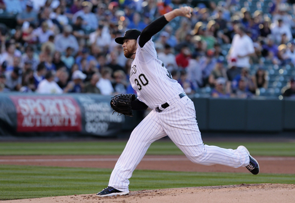 . Colorado Rockies starting pitcher Brett Anderson (30) delivers a pitch against the Chicago Cubs in the second inning of a baseball game in Denver on Tuesday, Aug. 5, 2014.(AP Photo/Joe Mahoney)