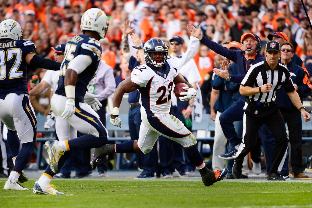 . SAN DIEGO, CA. December 14, - running back C.J. Anderson #22 of the Denver Broncos picks up yardage in front of the Broncos bench in the 2nd half vs the San Diego Chargers at Qualcomm Stadium December 14, 2014 San Diego, CA (Photo By Joe Amon/The Denver Post)