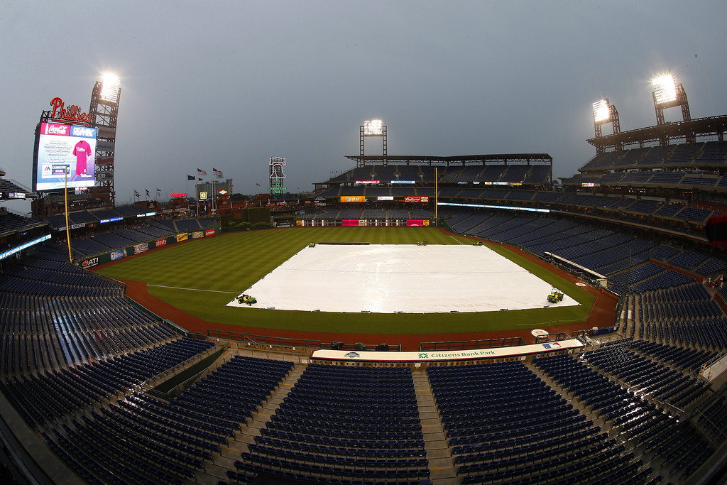 . A tarp covers the field during a rain delay before the start of a game between the Colorado Rockies and the Philadelphia Phillies at Citizens Bank Park on May 27, 2014 in Philadelphia, Pennsylvania. (Photo by Rich Schultz/Getty Images)
