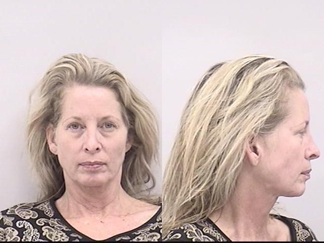 . Justine Herring, the Colorado Springs mayoral hopeful charged earlier this month in a laundry list of crimes including accusations she pointed a rifle at a man, was arrested again Monday on charges of assault and violating a protection order. Police say Herring, 48, was involved in a verbal altercation with her common-law husband at the couple\'s home on the 600 block Glen Eyrie Circle at about 8 a.m. (Colorado Springs Police Dept.)