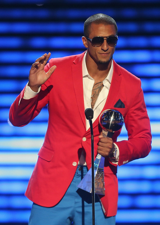 . NFL player Colin Kaepernick accepts the award for Best Breakthrough Athlete onstage at The 2013 ESPY Awards at Nokia Theatre L.A. Live on July 17, 2013 in Los Angeles, California.  (Photo by Frederick M. Brown/Getty Images for ESPY)