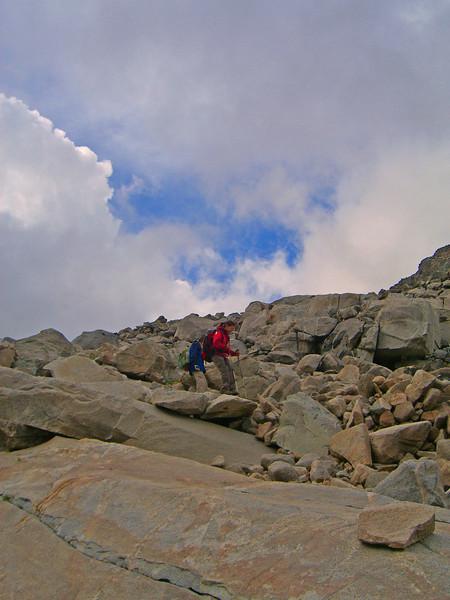 ann and doug negotiating boulders.jpg