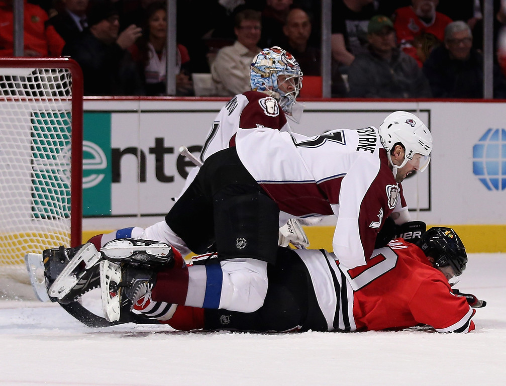 . Ryan O\'Byrne #3 of the Colorado Avalanche lands on top of Brandon Saad #20 of the Chicago Blackhawks at the United Center on March 6, 2013 in Chicago, Illinois. (Photo by Jonathan Daniel/Getty Images)