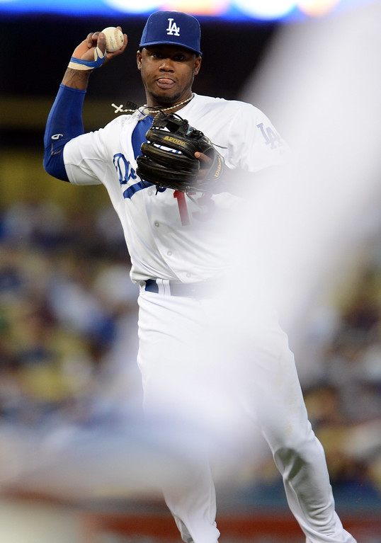 . The Dodgers\' Hanley Ramirez #13  throws to 1st for the out during game against the Red Sox at Dodger Stadium Friday, August 23, 2013 in Los Angeles. The Dodgers beat the REd Sox 2-0. (Hans Gutknecht/Los Angeles Daily News)
