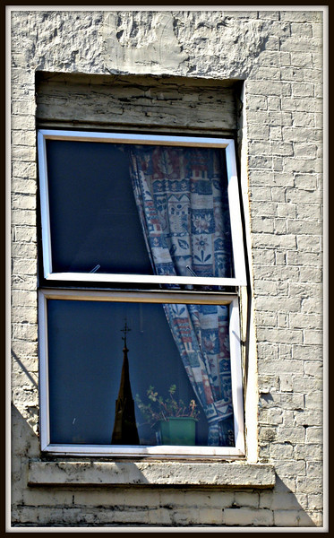 Reflection of Banbury Cross;  Window on High Street     Copyright ©2009 Florence T. Gray. This image is protected under International Copyright laws and may not be downloaded, reproduced, copied, transmitted or manipulated without written permission.