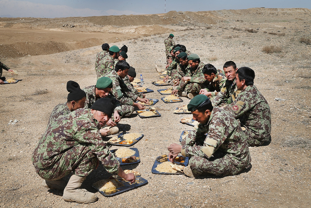 . KABUL, AFGHANISTAN - MARCH 18:  Soldiers with the Afghan National Army\'s (ANA) National Engineer Brigade take a break for lunch as they train with  U.S. Navy Seabees from Naval Mobile Construction Battalion (MCB) 28 at the ANA\'s combined Fielding Center on March 18, 2014 in Kabul, Afghanistan. The Seabees are attached to the U.S. Army\'s 130th Engineer Brigade are responsible for training ANA soldiers various engineering tasks at the facility.  (Photo by Scott Olson/Getty Images)