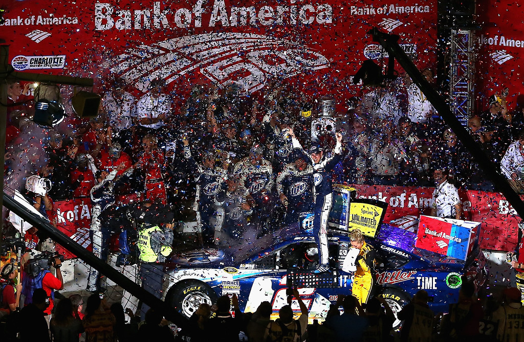 . CONCORD, NC - OCTOBER 12:  Brad Keselowski, driver of the #2 Miller Lite Ford, celebrates in Victory Lane after winning during the NASCAR Sprint Cup Series Bank of America 500 at Charlotte Motor Speedway on October 12, 2013 in Concord, North Carolina.  (Photo by Streeter Lecka/Getty Images)