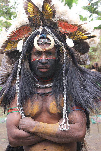 Huli wigman with bird of paradise feathers and boar's tusks