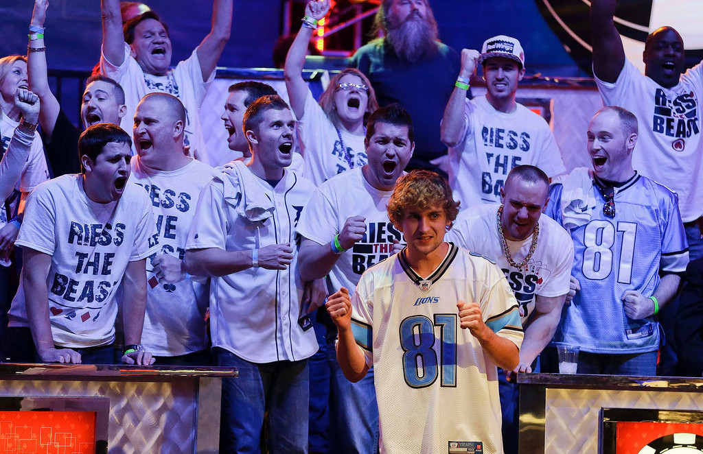 . Ryan Riess and his fans react as the river card is turned eliminating Amir Lehavot and advancing him to the final two players during the World Series of Poker Final Table, Tuesday, Nov. 5, 2013, in Las Vegas. (AP Photo/Julie Jacobson)