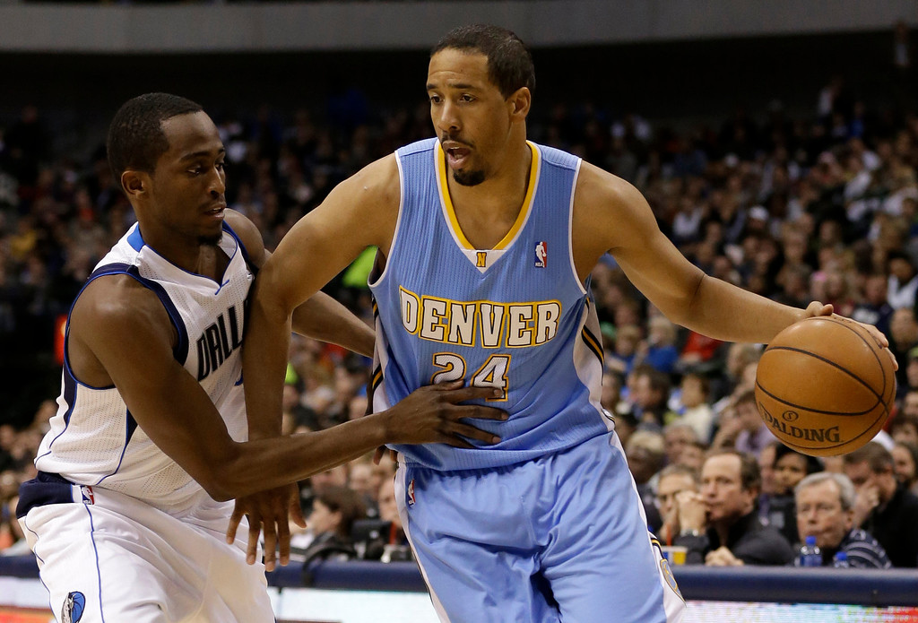 . Denver Nuggets point guard Andre Miller (24) attempts to get by Dallas Mavericks\' Rodrigue Beaubois, of Guadeloupe, in the first half of an NBA basketball game on Friday, Dec. 28, 2012, in Dallas. (AP Photo/Tony Gutierrez)