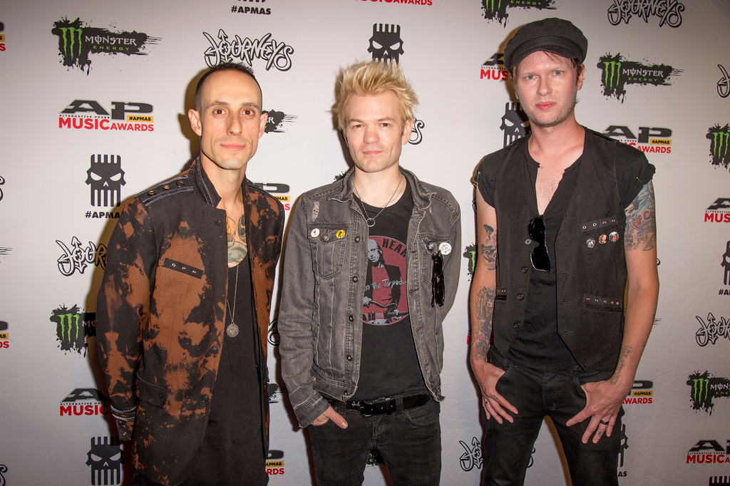 . Frank Zummo, from left, Deryck Whibley and Jason McCaslin of Sum 41 seen at 2017 Alternative Press Music Awards at the KeyBank State Theatre on Monday, July 17, 2017, in Cleveland. (Photo by Amy Harris/Invision/AP)