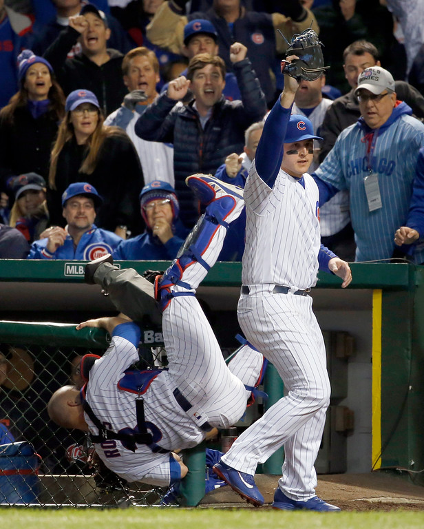 . Chicago Cubs first baseman Anthony Rizzo (44) reacts after catching a ball bounced off from catcher David Ross, who was trying catch a foul ball hit by Cleveland Indians\' Carlos Santana during the second inning of Game 5 of the Major League Baseball World Series Sunday, Oct. 30, 2016, in Chicago. (AP Photo/Nam Y. Huh)
