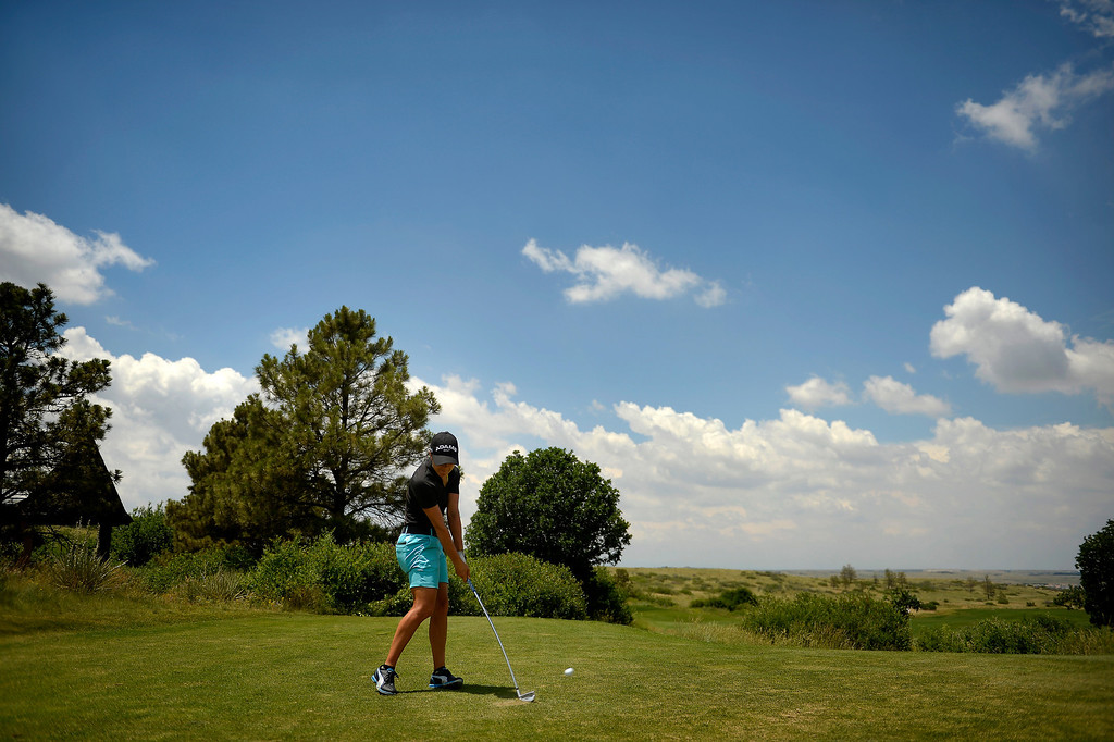 . Dewi Claire Schreefel of the Netherlands bends an iron off the tee as she practices with the 2013 European Solheim Cup Team as they take a look at the Colorado Golf Club in Parker, Colorado. The European team will play the Americans for the Solheim Cup in August. (Photo By Joe Amon/The Denver Post)