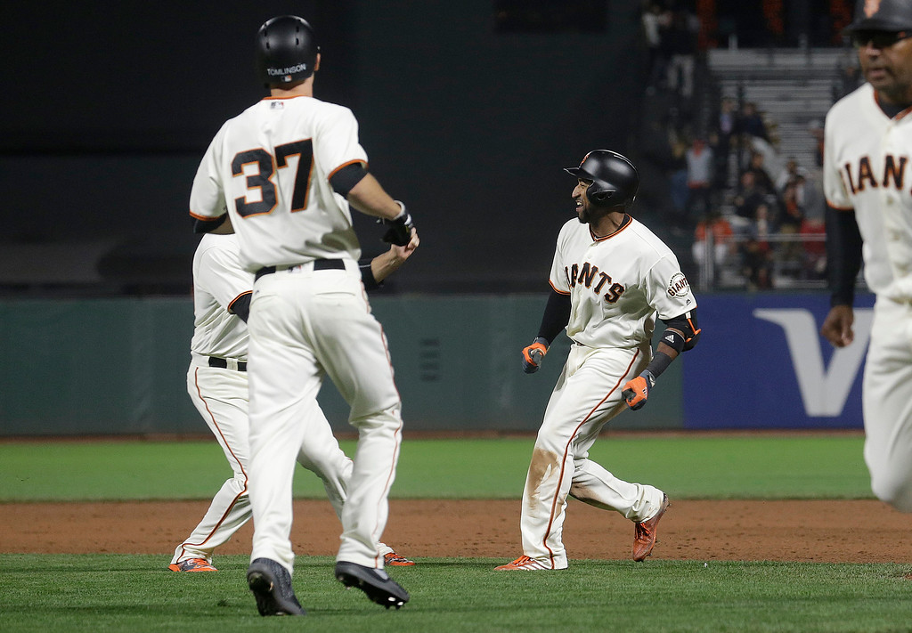 . San Francisco Giants\' Eduardo Nunez, right, celebrates with teammates after singling to score Kelby Tomlinson (37) for the winning run during the tenth inning of a baseball game against the Cleveland Indians in San Francisco, Tuesday, July 18, 2017. The Giants won 2-1 in ten innings. (AP Photo/Jeff Chiu)