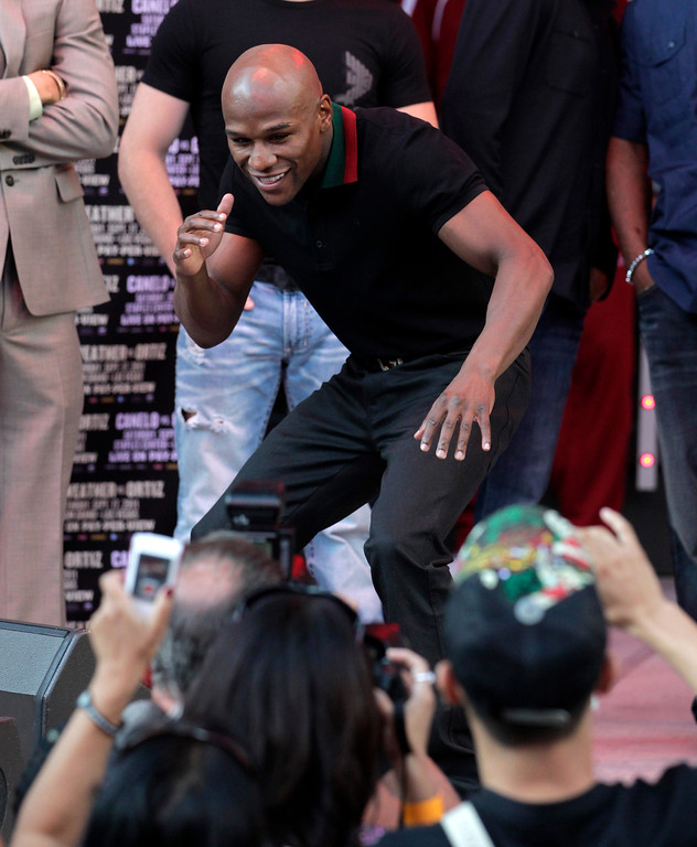 . Boxer Floyd Mayweather Jr. poses for photos at CityWalk in Universal City, Calif., Monday, Sept. 12, 2011. Mayweather Jr. will fight champion Victor Ortiz in a WBC welterweight title match, Saturday in Las Vegas. (AP Photo/Jae C. Hong)