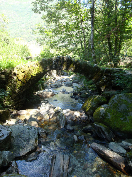 Stone bridge. The valley is filled with hiking trails and anciet hamlets populated by stone ruins and few people, due to modern urbanisation.