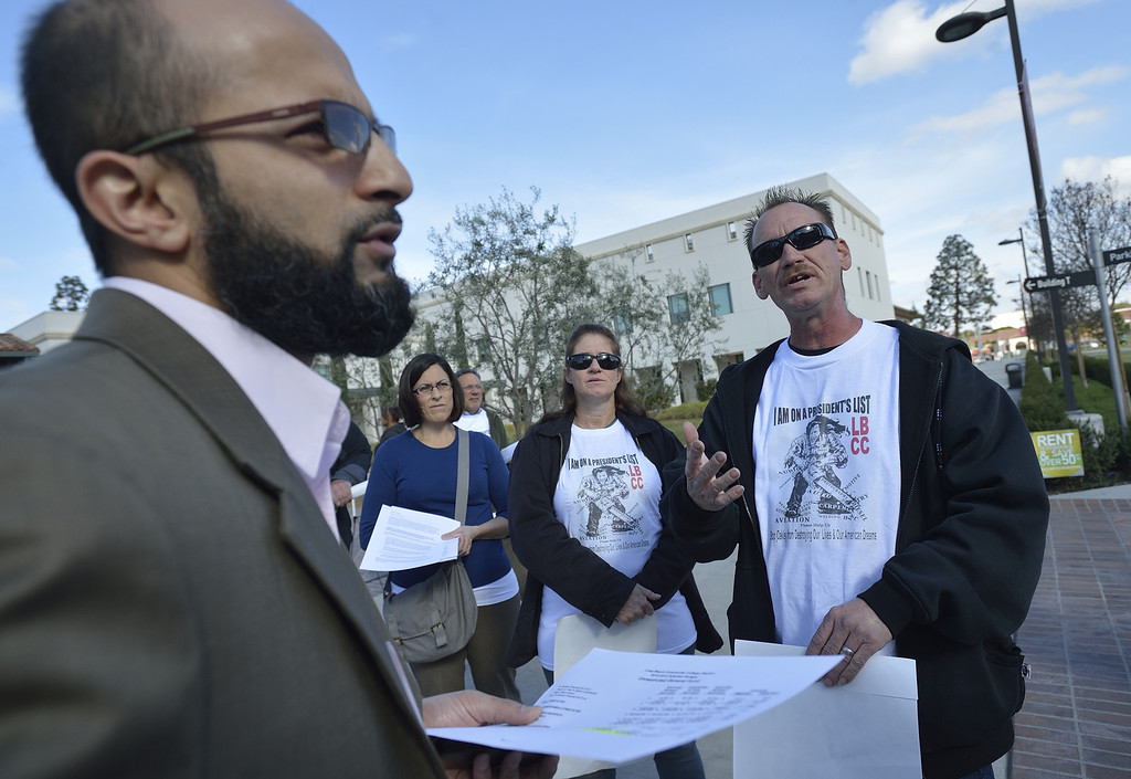 . LONG BEACH, CALIF. USA -- Auto body student David Root, right, explains his frustrations to Mufaddal Ezzy, higher education advisor for California Senate President pro Tem Darrell Steinberg (D-Sacramento) as Root joins other protesters at Long Beach (Calif.) City College on March 6, 2013. About 30 state senators visited LBCC as part of the Senate Education Policy Conference. Photo by Jeff Gritchen / Los Angeles Newspaper Group