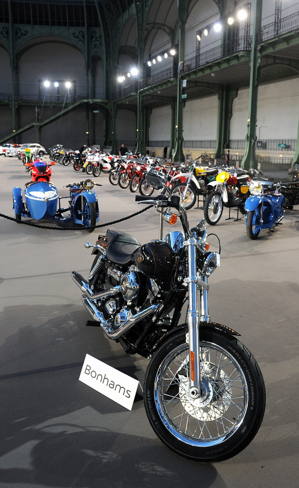 . The 2013 Harley Davidson 1 585 cm3 Dyna Super Glide Custom, donated to Pope Francis last year and signed by him on its tank,  is displayed ahead of Bonham\'s sale of vintage cars, at Le Grand Palais on February 5, 2014 in Paris, France.  (Photo by Antoine Antoniol/Getty Images)