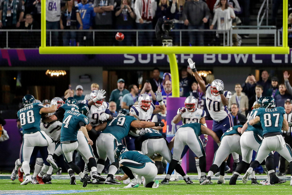 . Philadelphia Eagles kicker Jake Elliott (4) kicks a field goal against the New England Patriots, during the first half of the NFL Super Bowl 52 football game Sunday, Feb. 4, 2018, in Minneapolis. Philadelphia Eagles punter Donnie Jones (8), holds. (AP Photo/Chris O\'Meara)