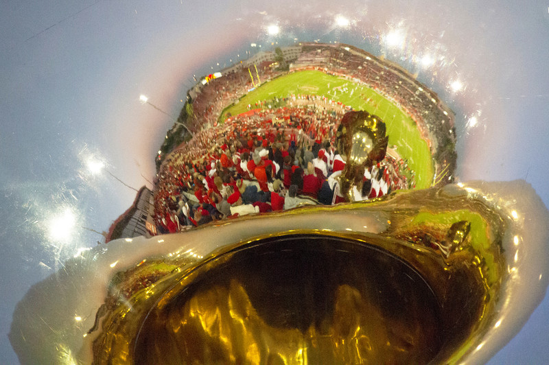 Robertson Stadium reflected in a tuba bell.