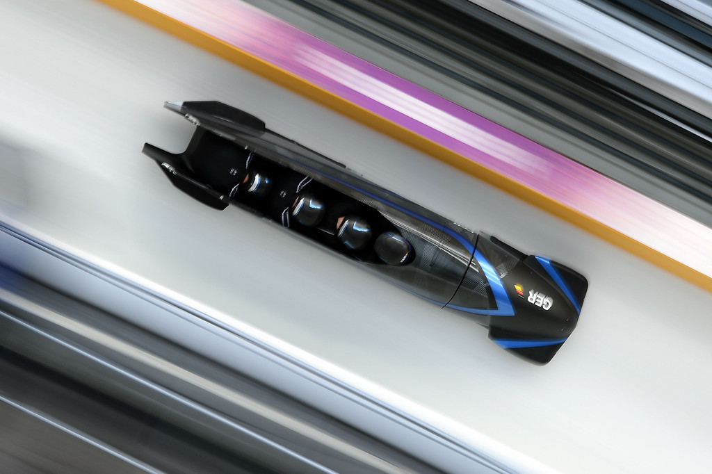. Germany-3 four-man bobsleigh, steered by Francesco Friedrich, takes part in a training session at the Sanki Sliding Center in Rosa Khutor during the Sochi Winter Olympics on February 21, 2014. LIONEL BONAVENTURE/AFP/Getty Images