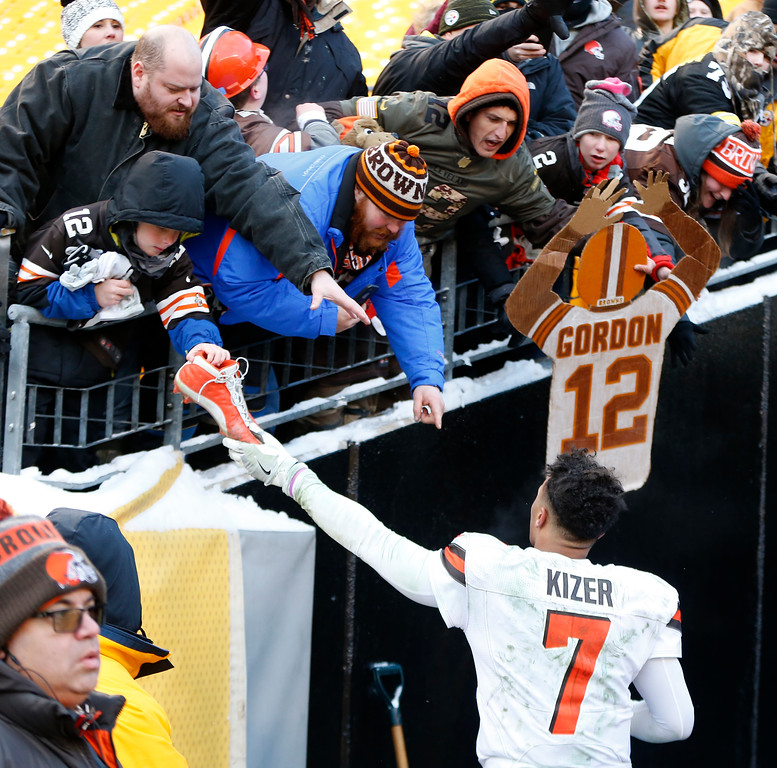 . Cleveland Browns quarterback DeShone Kizer (7) hands his shoe to a fan as he leaves the field following a 28-24 loss to the Pittsburgh Steelers in an NFL football game in Pittsburgh, Sunday, Dec. 31, 2017. (AP Photo/Keith Srakocic)