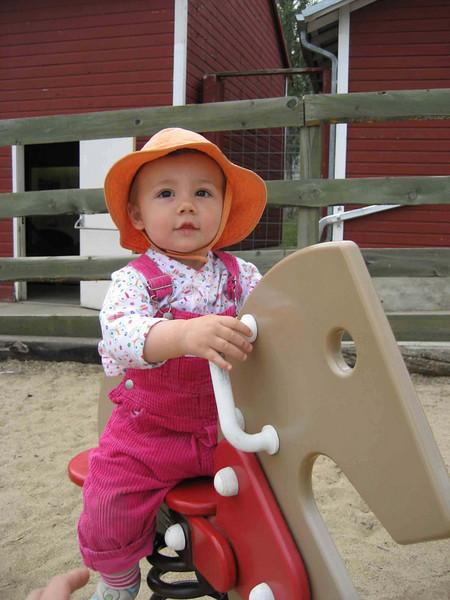 Farm sophia on wood horse.jpg