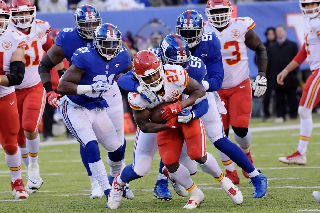 . New York Giants\' Devon Kennard (59) tackles Kansas City Chiefs\' Kareem Hunt (27) during the second half of an NFL football game Sunday, Nov. 19, 2017, in East Rutherford, N.J. (AP Photo/Bill Kostroun)