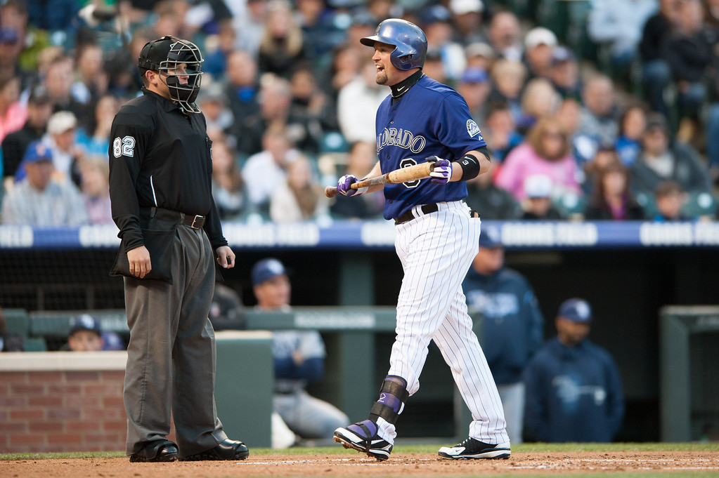 . DENVER, CO - MAY 4:  Michael Cuddyer #3 of the Colorado Rockies has a word for umpire Clint Fagan #82 at Coors Field on May 4, 2013 in Denver, Colorado. The Rockies led the Rays 1-0 after one inning. (Photo by Dustin Bradford/Getty Images)