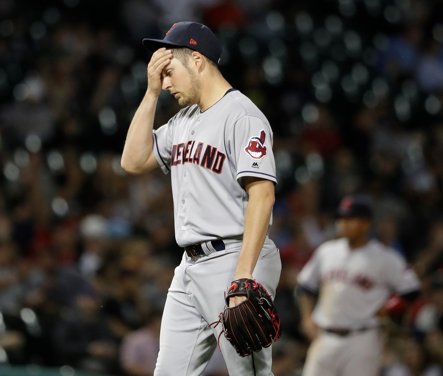 . Cleveland Indians starting pitcher Trevor Bauer wipes his forehead during the sixth inning of a baseball game against the Chicago White Sox Wednesday, June 13, 2018, in Chicago. (AP Photo/Charles Rex Arbogast)
