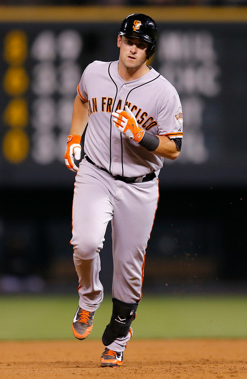 . San Francisco Giants\' Andrew Susac rounds the bases after hitting a two run home run off Colorado Rockies starting pitcher Jordan Lyles during the sixth inning of a baseball game Tuesday, Sept. 2, 2014, in Denver. (AP Photo/Jack Dempsey)