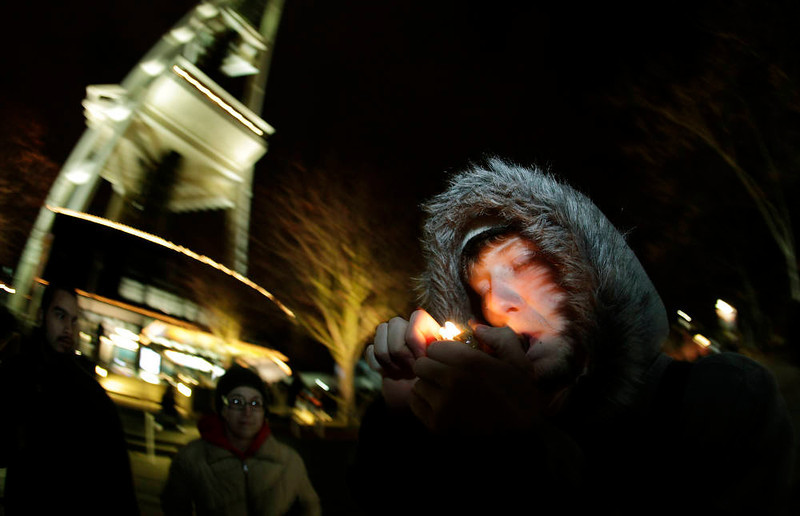 . C. Nash smokes marijuana in a glass pipe, Thursday, Dec. 6, 2012, just after midnight at the Space Needle in Seattle. Possession of marijuana became legal in Washington state at midnight, and several hundred people gathered at the Space Needle to smoke and celebrate the occasion, even though the new law does prohibit public use of marijuana. (AP Photo/Ted S. Warren)