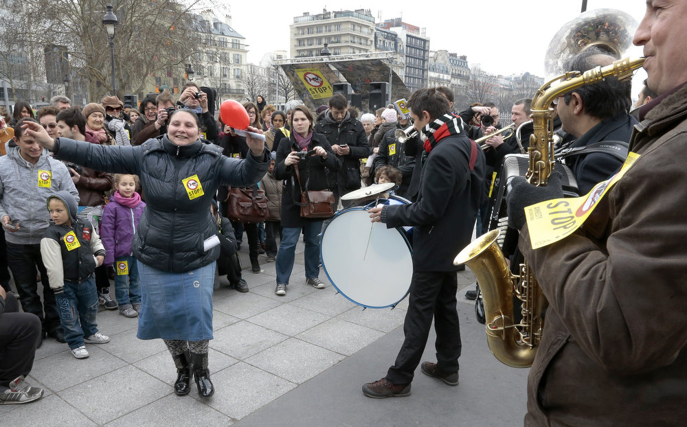 . People dance during an operation organized by Amnesty International to denounce Roma expulsions from France on April 6, 2013 in Paris.   JACQUES DEMARTHON/AFP/Getty Images