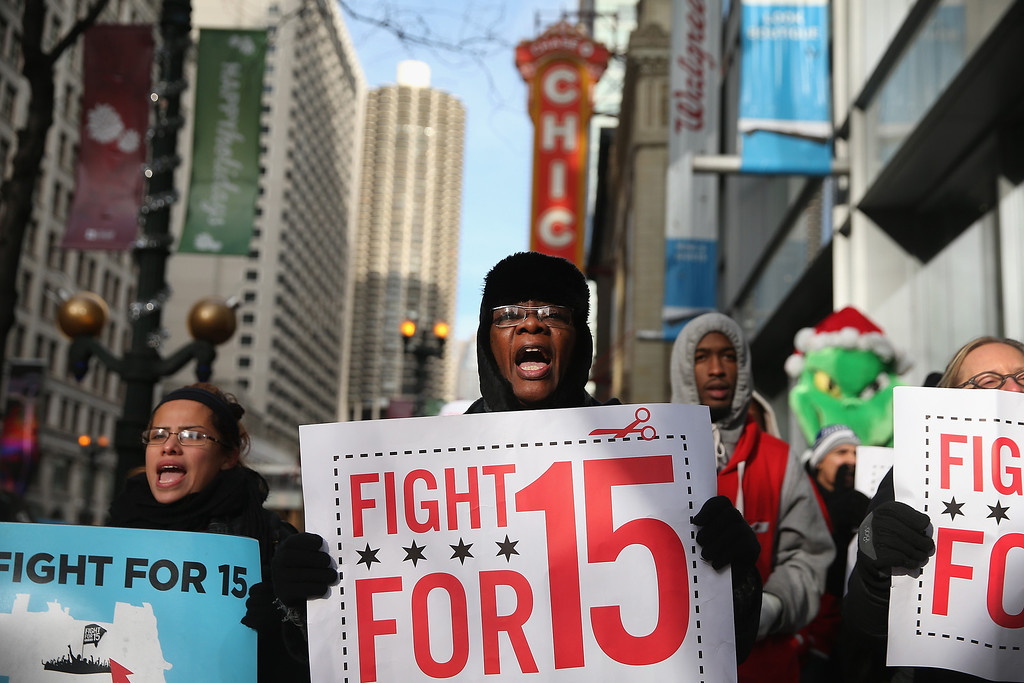 . Demonstrators demanding an increase in pay for fast-food and retail workers protest in the Loop on December 5, 2013 in Chicago, Illinois.  (Photo by Scott Olson/Getty Images)