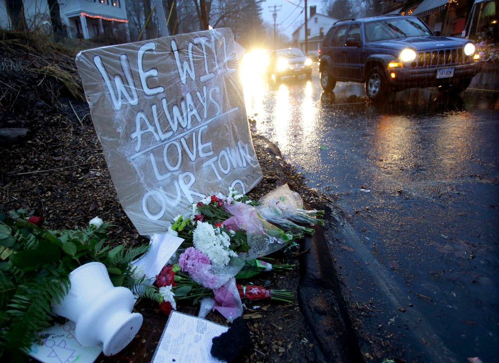 . Heavy rains soaked a memorial to the shooting victims in the Sandy Hook village of Newtown, Conn., Friday, Dec. 21, 2012.   The shooter, Adam Lanza, walked into Sandy Hook Elementary School in Newtown, Dec. 14, and opened fire, killing 26 people, including 20 children, before killing himself.� (AP Photo/Seth Wenig)