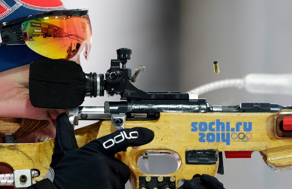 . Norway\'s Tora Berger shoots during the mixed biathlon relay at the 2014 Winter Olympics, Wednesday, Feb. 19, 2014, in Krasnaya Polyana, Russia. (AP Photo/Lee Jin-man)