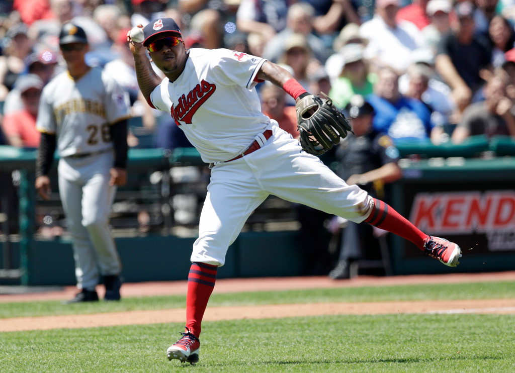 . Cleveland Indians\' Jose Ramirez throws out Pittsburgh Pirates\' Jordan Luplow at first base after Luplow bunted in the third inning of a baseball game, Wednesday, July 25, 2018, in Cleveland. (AP Photo/Tony Dejak)