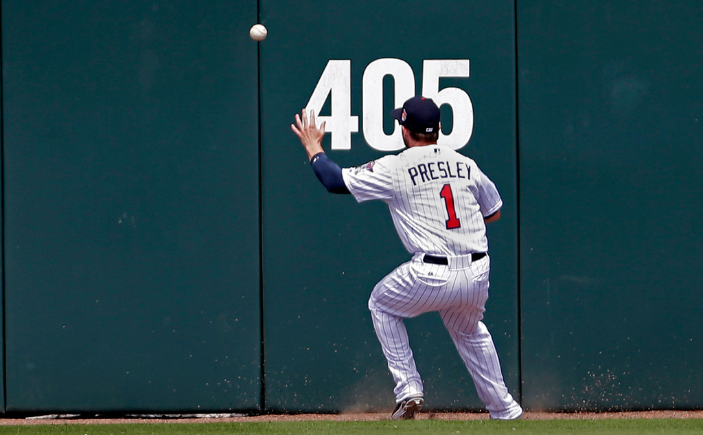 . Twins center fielder Alex Presley tries to corral a double to center by Pittsburgh\'s Jaff Decker during the third inning. (AP Photo/Gerald Herbert)