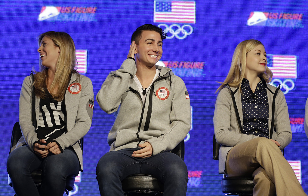 . American figure skater Max Aaron, center,  smiles as he talks with reporters while fellow American figure skaters Ashley Wagner, left, and Gracie Gold, right, look away during a press conference at the USOC 2013 team USA media summit Monday, Sept. 30, 2013, in Park City, Utah.  (AP Photo/Rick Bowmer)