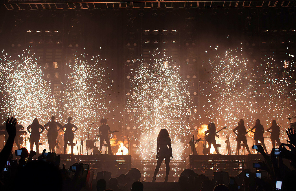". Singer Beyonce performs on her ""Mrs. Carter Show World Tour 2013,\"" on Saturday, Sept. 28, 2013 at the Coliceo de Puerto Rico in San Juan, Puerto Rico. (Photo by Robin Harper/Invision for Parkwood Entertainment/AP Images)"