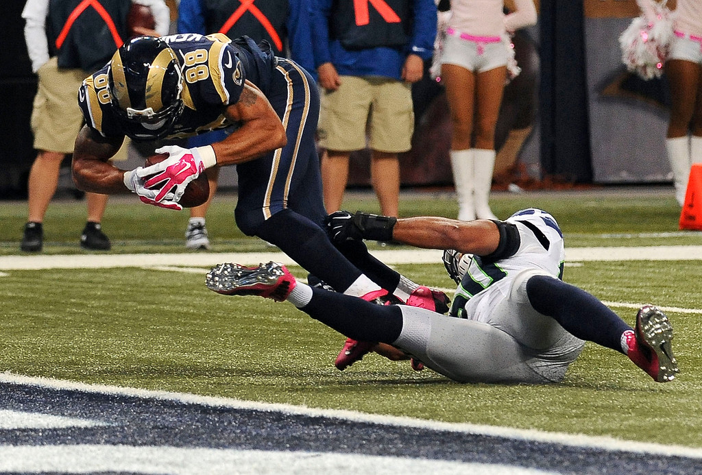 . St. Louis Rams tight end Lance Kendricks, left, falls into the end zone past Seattle Seahawks linebacker K.J. Wright after catching a 4-yard pass for a touchdown during the fourth quarter of an NFL football game Sunday, Oct. 19, 2014, in St. Louis. The Rams won 28-26. (AP Photo/L.G. Patterson)