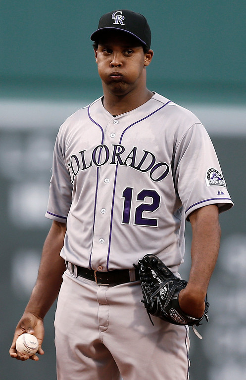 . Colorado Rockies starting pitcher Juan Nicasio pauses on the mound after giving up a run to the Boston Red Sox during the first inning of a baseball game at Fenway Park in Boston on Tuesday, June 25, 2013. (AP Photo/Winslow Townson)