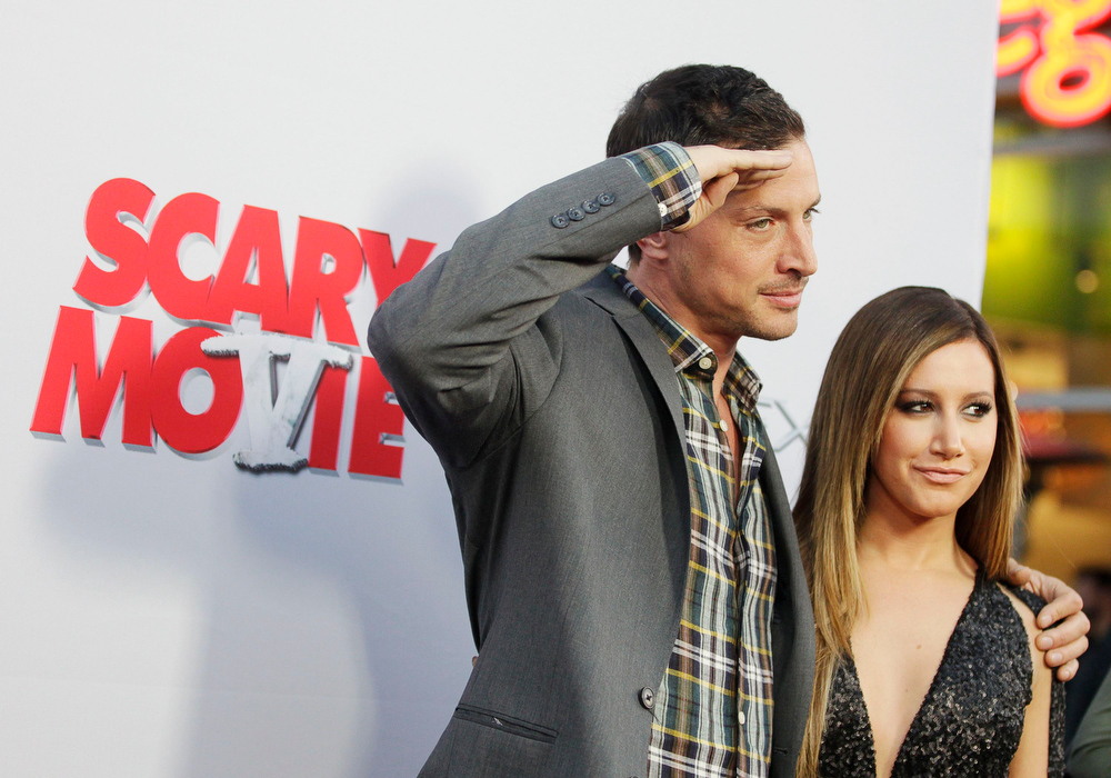 """. Cast members Simon Rex (L) and Ashley Tisdale arrive at the premiere of their new film \""""Scary Movie 5\"""" in Hollywood April 11, 2013. REUTERS/Fred Prouser"""