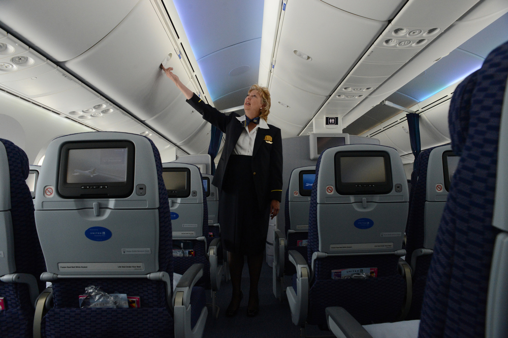 . United Airlines Flight Attendant Pam Pace talks about the the large stowage bins while touring the 787 Dreamliner at Denver International Airport on Thursday, Nov. 29, 2012. By March, the new jet is scheduled to begin flying between Denver International Airport and Japan\'s Narita International Airport. Craig F. Walker, The Denver Post