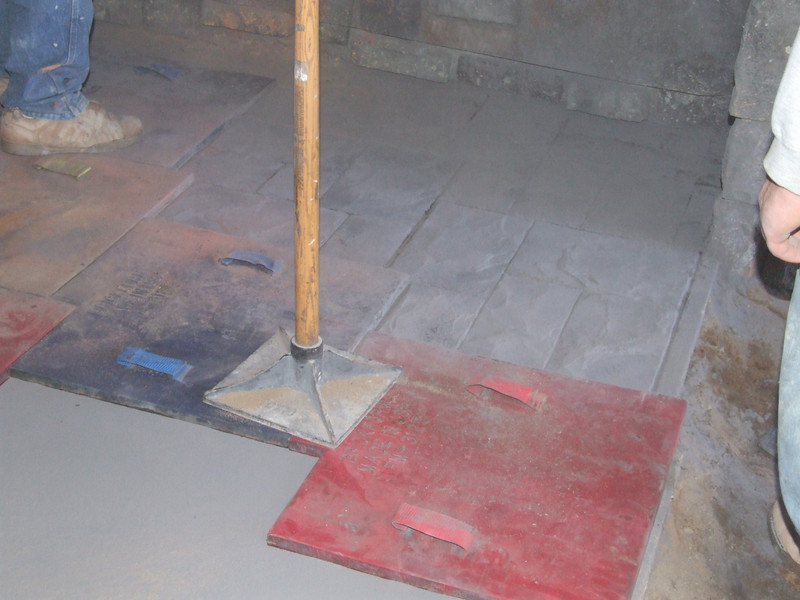 They use these tools to tamp down the cement stamp