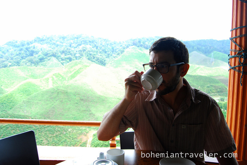 Stephen drinking tea at Cameron Valley Tea fields [Bharat].jpg