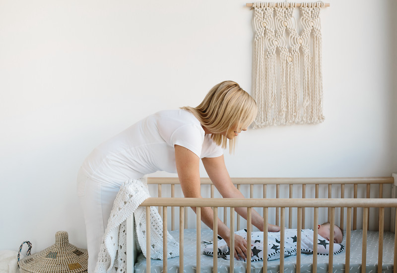 Love_To_Dream_Stage_1_Original_Designer_Collection_Starry_Night_Lifestyle_Mum_Reaching_Into_Cot.jpg