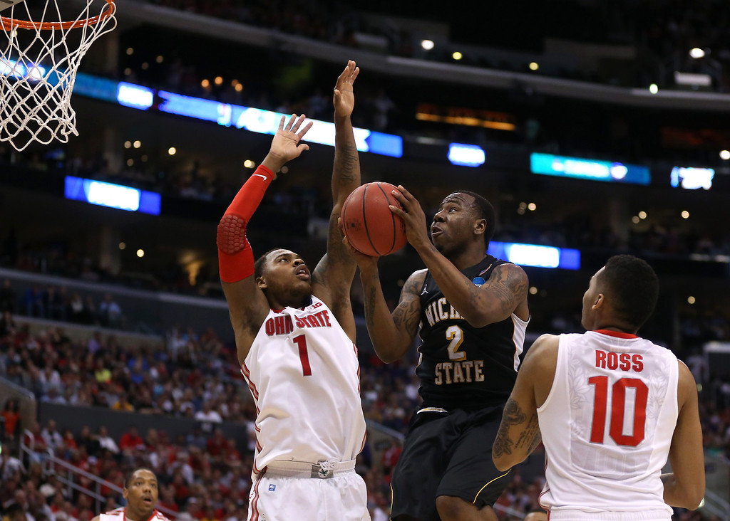 . LOS ANGELES, CA - MARCH 30:  Malcolm Armstead #2 of the Wichita State Shockers goes up for a shot against Deshaun Thomas #1 and LaQuinton Ross #10 of the Ohio State Buckeyes in the second half during the West Regional Final of the 2013 NCAA Men\'s Basketball Tournament at Staples Center on March 30, 2013 in Los Angeles, California.  (Photo by Jeff Gross/Getty Images)