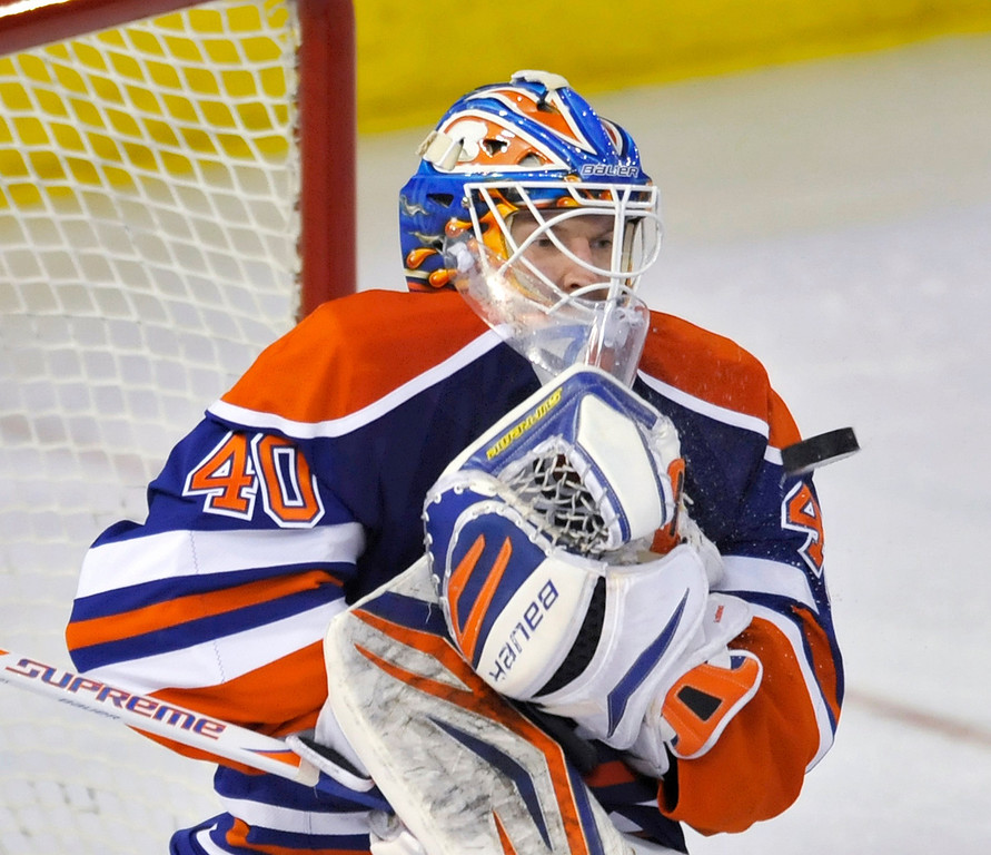 . Edmonton Oilers goalie Devan Dubnyk makes a save against the Colorado Avalanche during the second period of their NHL hockey game in Edmonton January 28, 2013.  REUTERS/Dan Riedlhuber