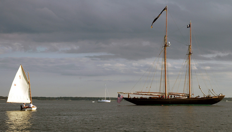 Mark Powell aboard Grace with the Schooner Virginia anchored in Fishing Bay